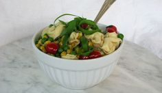 Sugar Snap Peas, Fresh Corn, And Grape Tomato Pasta Salad- using cheese tortellini and fresh basil-simple and delicious