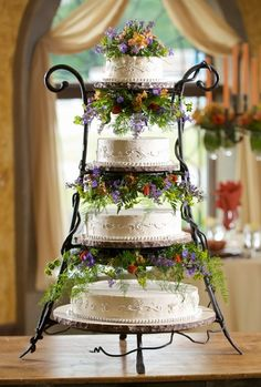 It's all in the cake stand and the flowers for this wedding cake