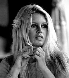 French actress Brigitte Bardot with a flower in her hair on the set of 'Shalako', directed by Edward Dmytryk, (Photo by Terry O'Neill:Hulton Archive:Getty Images) 1968 Bridget Bardot, Brigitte Bardot, Terry O Neill, Bardot Hair, Robert Doisneau, Catherine Deneuve, French Actress, Belle Photo, Old Hollywood