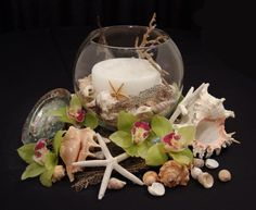 Cool beach wedding centerpiece with burlap and shells