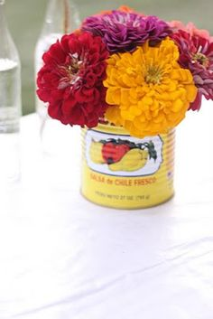 Like the idea of Mexican beans and tomatoe cans along w tequila and Mexican beer bottle w clear glass and turquoise tinted glass bottles to hold flowers peppers lemons and limes clustered on tables Mexican Beer, Mexican Party, Mexican Babies, Tacos And Tequila, Fiestas Party, Party Fiesta, Fiesta Decorations, Cute Wedding Dress, Perfect Wedding