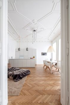 """Apartment H+M is a minimalist house located in Wien, Austria, designed by destilat. The """"Apartment H+M"""" project comprises the restoration of a in a classic Viennese old building on the piano nobile of a house that was built at the turn of the century. House Design, Apartment, House Interior, House, Interior Architecture, Home, Herringbone Floor, Modern Renovation, Home Decor"""