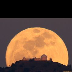 Full Moon behind Mount Hamilton, east of San Jose, California on March 7. James Lick Observatory in silhouette.