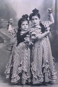 Little flamencas... with castanets at the ready...