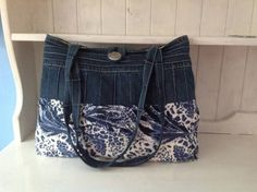 Love blue jean upcycles..this needs a ribbon/bow where the two fabrics join.