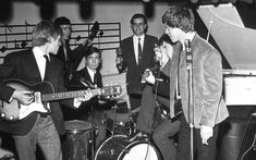 """Just a few months after the band's first gig, changes to the line-up were made. Bill Wyman replaced Mick Taylor as bassist in December 1962, while drummer Tony Chapman was replaced by Charlie Watts in January 1963. The same year pianist Ian Stewart (above with maracas) was forced to leave the group as he didn't fit the """"pretty, thin, long-haired"""" image that their manager Andrew Loog Oldham was trying to cultivate, according to Wyman."""