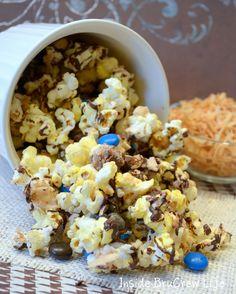 Almond Joy Popcorn from insidebrucrewlife.com - popcorn, almonds, and coconut covered in chocolate #popcorn #coconut