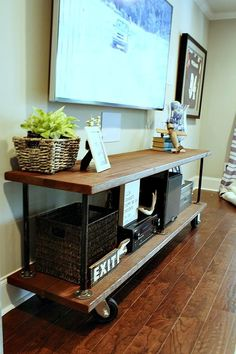 Perfect DIY for under the big screen. Industrial build from refreshrestyle.com