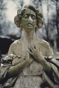 The Décolleté Angel, Highgate Cemetery East.    One of my own photos, scanned.