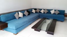 MINIMALIST Living-Room by Canela Bali. Minimalist living-room set with blue corner sofa and small cushions with fully detachable covers to facilitate the washing. Get yours on https://www.canelabali.com/