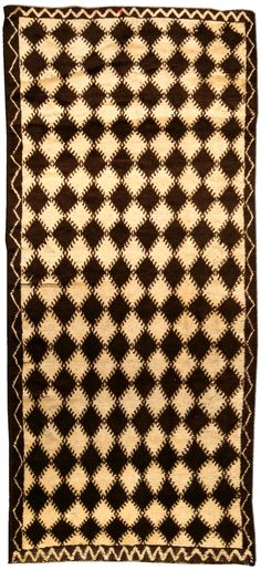 A vintage Moroccan rug BB4556 - A second quarter 20th century Moroccan rug, the beni quarain carpet, the oatmeal field with a lattice of solid ...
