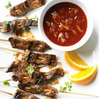 Beef-on-a-Stick  In this easy recipe from Sandra Lee, strips of sirloin are marinated in pineapple and orange juices, soy sauce, and mustard, and then grilled.