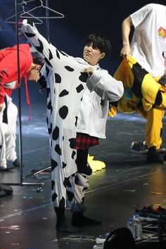 Only he could look so perfect in a cow onesie