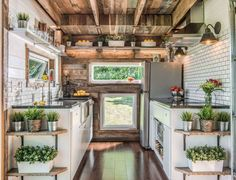With a farmhouse sink, chic subway tile backsplashes, and plenty of sources of natural light, this sleek abode is one for the books.