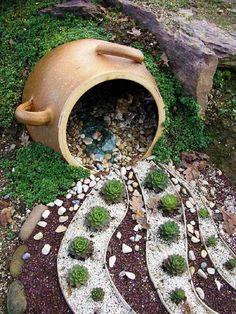 Pebble and Succulent Arrangement