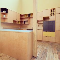 The old showroom kitchen in the Kerf Office. Shows you just what we're capable of. Maple europly with custom color laminate. Peep the wine rack. Made by Kerf Design in Seattle Washington kerfdesign.com