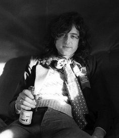 jimmy page with alcohol and bedroom eyes....yikes! we are all in trouble! :P