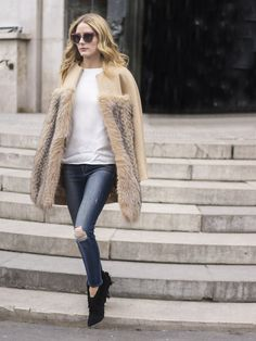 Pin for Later: 50 Styling Lessons to Steal From Fashion Month's Best Dressed Elevate your jeans with a furry jacket.