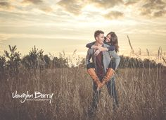 Sunset field engagement photo by Vaughn Barry Photography in Barrie, Ontario http://vaughnbarry.com