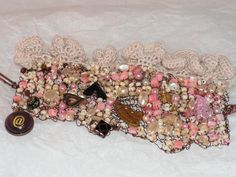 Victoriana - Hand knitted wire bracelet with soft ruffle crochet on the edge