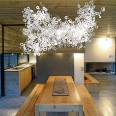 """Oh Oh  It's raining donuts. Thousands of them all randomly linked in clusters of polycarbonate or metal elements interspersed with LED bipin lights.  Design: Conrad Johnsson  Dimensions shown: 2300 L x 2000 W x 1800mm H (7' 7"""" L x 6' 7"""" W x 5' 10"""" H) Material: Opal polycarbonate. Available in other materials and finishes. Lighting: LED bi pins"""