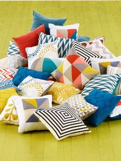 Pile on the decorative pillows. You can never have too much color or graphic print.