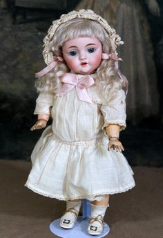 Offered is a darling Kestner 143 character in a cute 12 size. Her bisque socket head is perfect without damage or restoration and is marked  Made in
