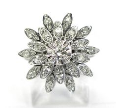 Ladies 14kt white gold diamond estate ring. Ring contains 21 round diamonds weighing a total of approximately .33ct.