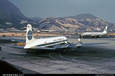 Pan Am planes at the old Kai Tak Airport, Hong Kong - a scary airport to land in and take off from due to a very short runway.  (Google Search)