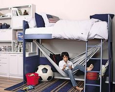 Love the loft beds with a hammock for a teen boys bedroom