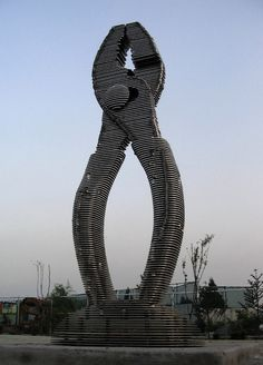 Sliced Metal giantic...Screw Driver....Sculpture by Korean Sculptor Chan Girl Park.