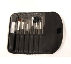 Rucci Cosmetic Brush Set, Small by Rucci. $16.95. Great for travelling and daily use. Handy bag. Great for women in-the-go. 7-pc makeup brush set in a pouch.