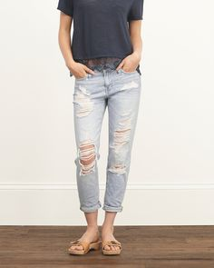 Relaxed through the leg, this boyfriend jean has a low rise waist that hits right below the belly button, hand-done destruction, rolled cuffs, Shredded Light Wash, Imported <br><br> Inseam (inches): 25