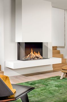 The experience of every living: a modern gas fireplace by BRUNNER, whether floating or . - The experience of every living: a modern gas fireplace by BRUNNER, whether floating or traditional. Gas Fireplace Mantel, Floating Fireplace, Fireplace Remodel, Living Room With Fireplace, Living Room Decor, Fireplace Modern, Gas Fireplaces, Fireplace Ideas, Contemporary Fireplace Designs
