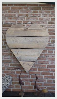 So cute to hang outside made of old pallets...we always have tons of those laying around.