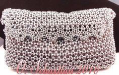 Not jewelry, but a really cool use of chain maille.  Japanese 12-in-2 chain maille purse with crystals.