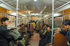 Difference between the North and South Korea. Here a scene in the Pyongyang Metro in North Korea. It's crazy to see how the North Koreans seem so unhappy and no playful, compared to the previous photo in the Metro Seoul in South Korea. South Korea North Korea, Popular Photography, Amazing Photography, Korean People, Architectural Photographers, Time Photo, Photo Story, Capital City, Photo Book