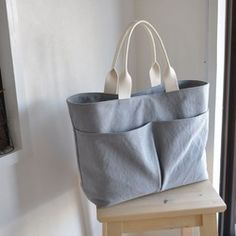 Travelus travel bucket shoulder bag by Byfulldesign. The travel bucket shoulder bag bag is a perfect bag to use for travel or everyday use. Fabric Tote Bags, Diy Tote Bag, Diy Purse, Canvas Tote Bags, Handmade Handbags, Handmade Bags, Diy Bag With Zipper, Linen Bag, Cotton Bag