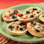 These mouthwatering pizza snacks start with toasted mini bagels topped with garlic, olives, green pepper and mozzarella cheese.      I'M gonna make it without the olives, garlic and peppers! (SO BASICALLY, cheese pizza. :P)    You could ALSO try grilling it/ frying it like grilled cheese, and adding pepperoni.
