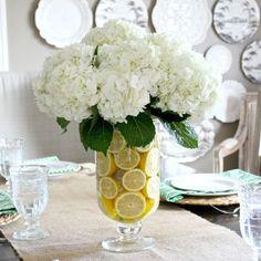 Sliced lemons make a beautiful vase filler for this spring centerpiece