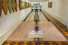 Retro Modern Home Bowling Alley by Fusion Bowling via houzz: Built from some 1950's lanes with a vintage above the floor ball return. #Bowling_Alley #Home