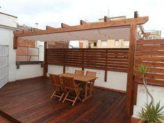 Pergola de madera de abeto laminado instalado en una terraza en barcelona .  www.fustmar.com