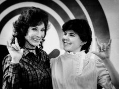 """Loretta Lynn, left, and Julie Bartee, 17, make the sign for """"I Love You"""" during filming of a United Way spot at the Bill Wilkerson Speech and Hearing Center on April 3, 1984.  