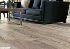 This living room floor is porcelain tile that looks like hardwood. The wood look tile is from the Rustic series and known as French Oak. Porcelain Flooring, Flooring, Wood Tile, Wood Look Tile, Wood Grain Tile, Wood Laminate Flooring, Wood Tile Floors, Wood Floors, Living Room Flooring