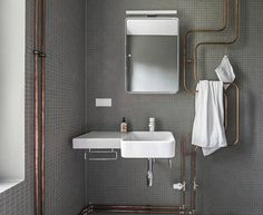 Improvised life  BLOG Karhard We've long been fans of copper plumbing pipes being configured on the OUTSIDE of bathroom walls to make interesting sculptural fixtures (not to men