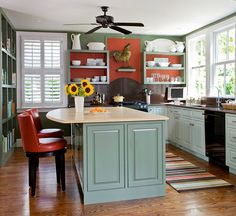 Bold accent walls make sleek white dishes stand out. More kitchens we want to cook in: http://www.bhg.com/kitchen/styles/cottage/cottage-style-kitchen/?socsrc=bhgpin031513greenkitchen