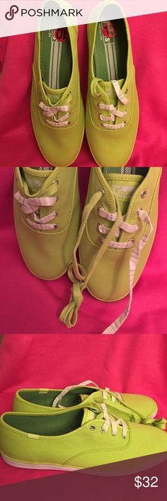 Keds Sneakers with 2 sets of Shoe Laces Authentic Keds Neon Green Sneakers have 2 Sets of Shoe Laces. One is Neon Green & White Striped. The other is Solid Neon Green. Wear the 2 sets separately or overlapping together. Keds Logo on the Front Flaps. Canvas with Rubber Soles. Brand New. Excellent Condition. No Trades. keds Shoes Sneakers