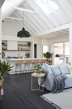 love the ceiling beams, kitchen island. don't like dark floors