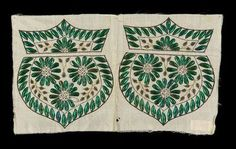 Fabric decorated with beetle wings, looks like it's for a reticule