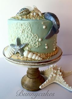 """Sophisticated Mermaid themed birthday cake with fondant mermaid tail, fondant seashells and sugar cookie """"sand"""". By Bunnycakes"""